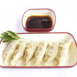 Plate of steamed dumplings with soy sauce — Stock Photo #50836315