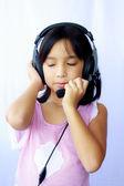 Asia girl wearing headphones on white background — Foto Stock