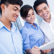 Stock Photo: Business team with digital tablet