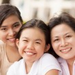 Granddaughters and grandmother — Stock Photo
