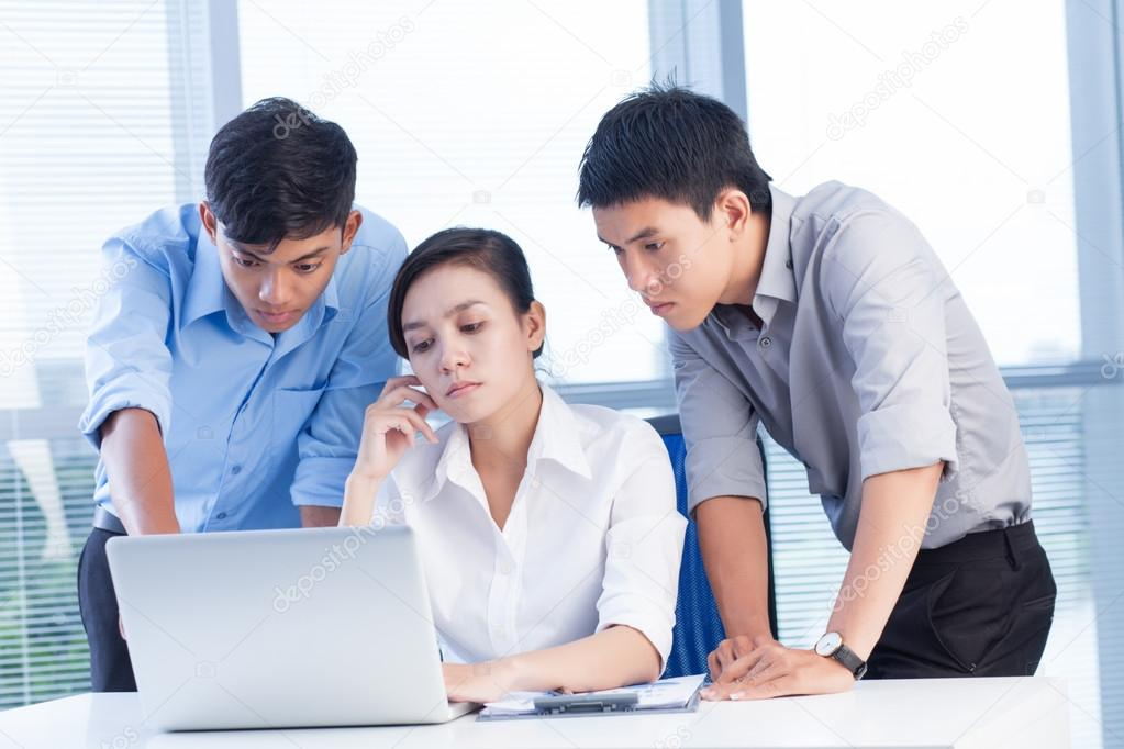 A business team of three planning work in office — Stock Photo #12583491