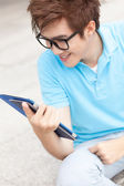 Teenager with touchpad — Stock Photo