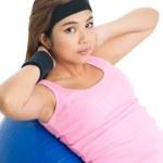 Girl on gymnastic ball — Stock Photo