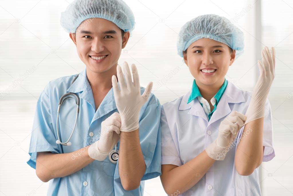 Team of cheerful medical workers preparing for a surgery  Stockfoto #13901924