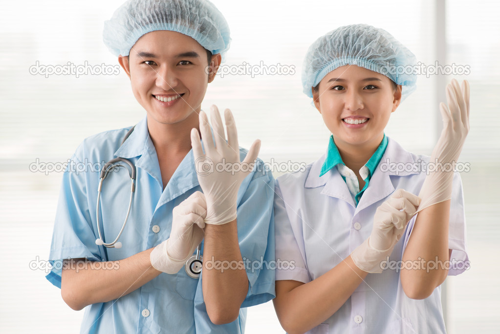 Team of cheerful medical workers preparing for a surgery   #13901924