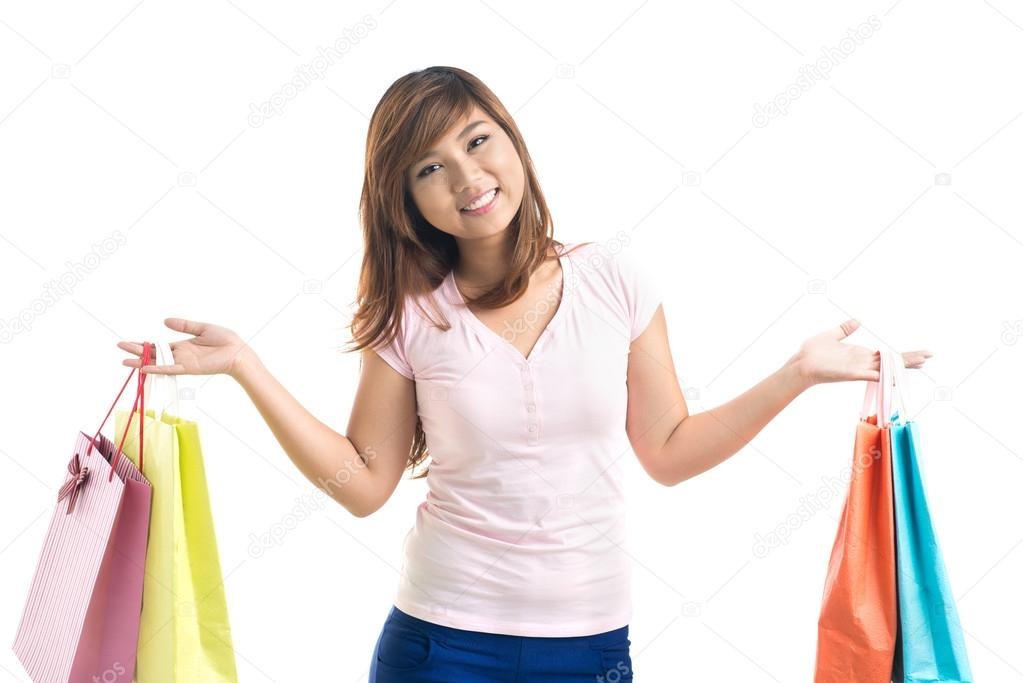 Portrait of a young girl showing her bags  Stock Photo #13902566