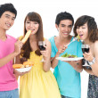 Eating at party — Stock Photo #14226193