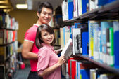 Library couple — Stock Photo