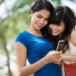 Messaging girlfriends — Stock Photo