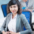 Young businesswoman in office - Stock Photo