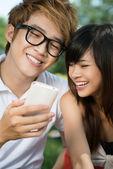 Couple with phone — Stock Photo