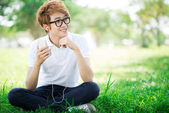 Boy with mp3 player — Stock Photo