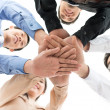 Conceptual shot of a dedicated business team joining hands — Stock Photo #18768601