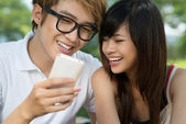 Teens with gadget — Stock Photo