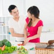 图库照片: Kitchen flirt