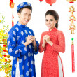 Vietnamese couple on Tet — Stock Photo #18786633