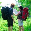 Tourists in the forest — Stock Photo
