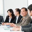 Stock Photo: Group of smiling businessmen