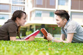 Studying on campus lawn — Stock Photo