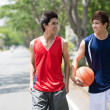 Talking young sportsmen — Stock Photo