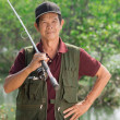 Stock Photo: Skillful fisherman