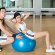 Fitness-ball sit-ups - Stock Photo
