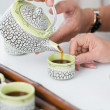 Pouring tea — Stock Photo