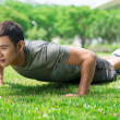 Doing push-ups — Stock Photo