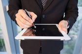 Holding stylus pen — Stock Photo