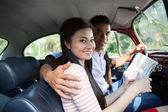Hugging in a car — Stock Photo