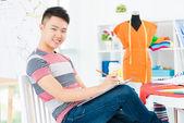 Happy dressmaker at work — Stock Photo