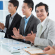 Foto Stock: Applauding businessman