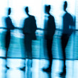Blurred businesspeople — Stock Photo