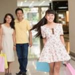 Cheerful teenager at shopping — Stock Photo