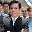 Businessman and his team — Stockfoto