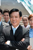 Businessman and his team — Stock Photo