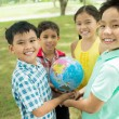 Kids with globe — Stock Photo