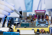 Microchip assembling — Stock Photo