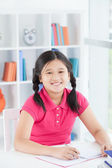 Diligent schoolgirl — Stock Photo