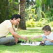 Playing chess with dad — Stock Photo