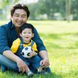 With daddy — Stockfoto