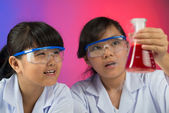 Excited young chemists — Stock Photo