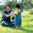 Playing with father — 图库照片