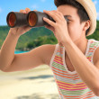 With binoculars — Stock Photo