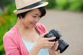 Looking through the photos — Stock Photo