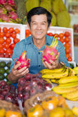 Cheerful husband in the market — Foto Stock