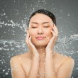 Splash on face — Stock Photo