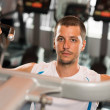 Man at exercise machine — Stock Photo