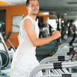 Man on treadmill — Stock Photo