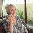 Stock Photo: Call from retiree
